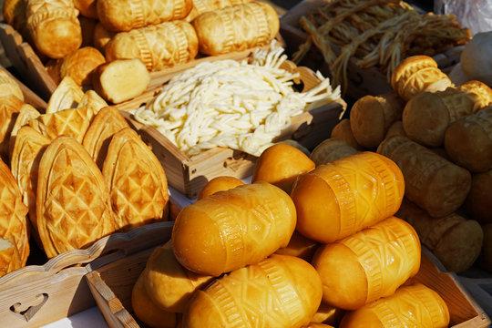 Traditional Slovak smoked sheep cheese on farmers market (Ostiepok)