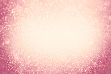 Abstract bokeh background. Christmas Glittering background. Abstract christmas coral color background. Glittering Christmas background. Pink christmas background Glitter christmas background