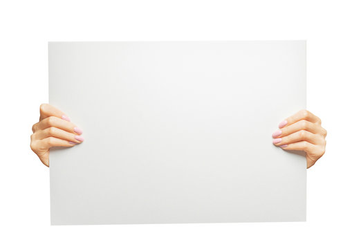 Female hands holding blank poster, copy-space.