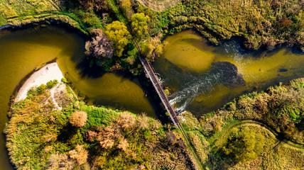 Old Bridge Over Nida River Bend in Swietokrzyskie,Poland. Aerial Drone View