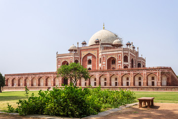 Side Panorama of Humayun's Tomb Complex with square, park and vegetation. UNESCO World Heritage in Delhi, India. Asia.