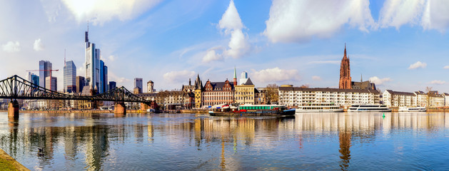 Wide color panorama of the city of Frankfurt am Main,skyscrapers,cathedral,sky clouds,...