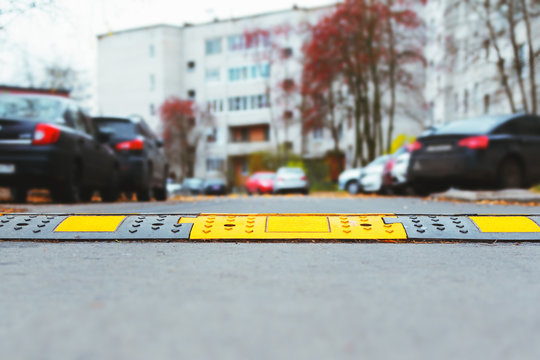 photo of a speed bump mounted in asphalt