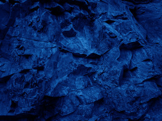 Dark blue abstract stone background. Navy blue rock backdrop. Mountain close-up.