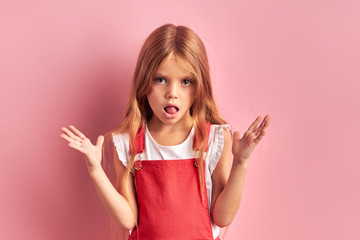 Amusing girl of caucasian appearance with opened mouth look at camera isolated over pink background