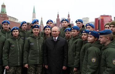Russian President Putin and members of youth organizations attend a ceremony marking the National Unity Day in Moscow