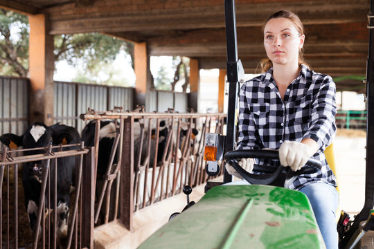Female farmer working on tractor