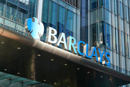 London, United Kingdom - February 03, 2019: Blue Barclays logo at their worldwide headquarters in Canary Wharf. It is British multinational investment bank, one of largest world banks.