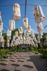 Colorful paper lanterns decorated in open travel place Ho Van in Hanoi, Vietnam with blue sky background