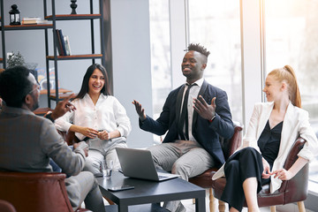 Business and Education concept. African business coach sit in office with colleagues