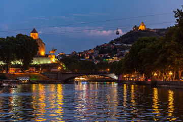 Fototapete - Tbilissi and Kuri river cityscape at night capital city of Georgia eastern Europe
