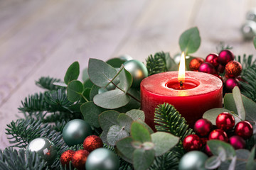 Fototapeta Christmas candle with fir branches and eucalyptus leaves on rustic wooden background  -  Advent time obraz