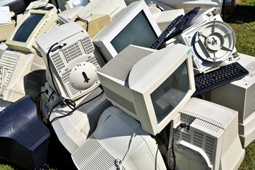 Pile of old computer monitors and keyboards