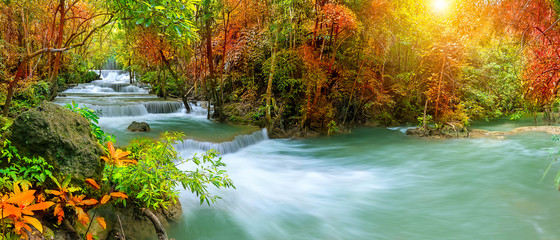 Door stickers Waterfalls Colorful majestic waterfall in national park forest during autumn, panorama - Image