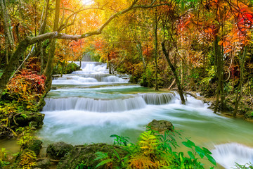 Colorful majestic waterfall in national park forest during autumn - Image Wall mural