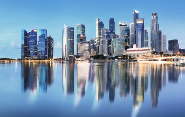 Fotomurales - Singapore skyline at sunrise - panorama with reflection
