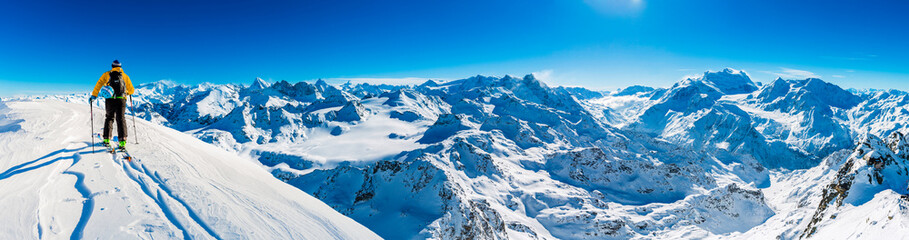 Skiing with amazing view of swiss famous mountains in beautiful winter snow  Mt Fort. The matterhorn and the Dent d'Herens. In the foreground the Grand Desert glacier. Wall mural