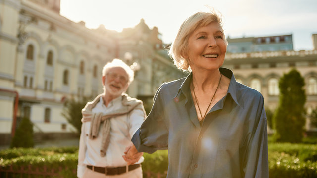 Your love is all I need. Beautiful and happy senior couple holding hands and smiling while spending time together outdoors