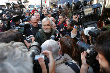 French writer Jean-Paul Dubois arrives after he received the French literary prize Prix Goncourt in Paris