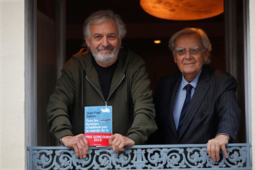 French writer Jean-Paul Dubois poses next to Jury member Bernard Pivot after he received the French literary prize Prix Goncourt in Paris