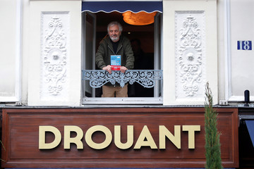French writer Jean-Paul Dubois poses at the Drouant restaurant after he received the French literary prize Prix Goncourt