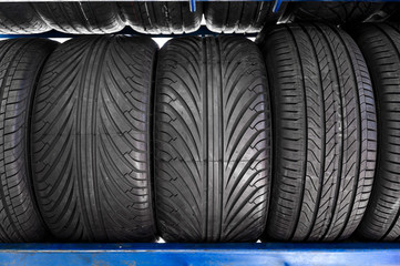 Close up new tyres on shelve in tire shop