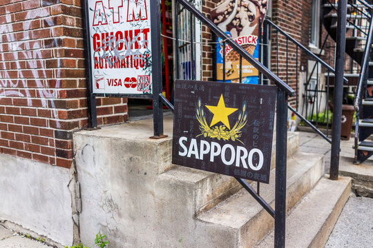 Montreal, Canada - May 27, 2017: Sapporo Japanese sign by liquor store in Plateau neighborhood in city in Quebec region