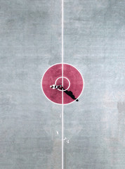 Aerial view of person standing in the center circle of basketball court