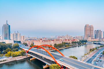Dusk scenery of Haihe River and Jingang Bridge in Tianjin, China Papier Peint