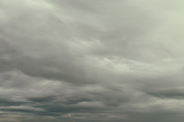 Soft background with stratus clouds. Dramatic cloudscape under cinematic color filter.