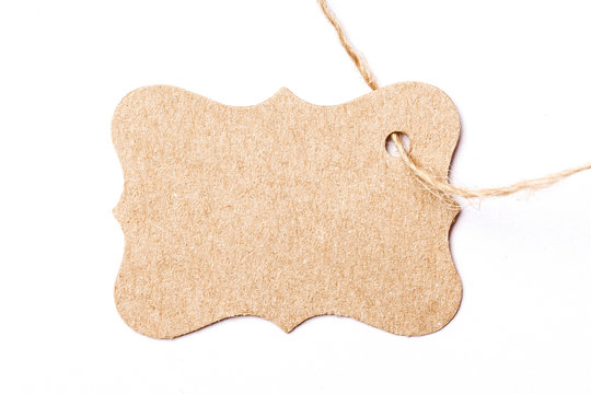 Brown paper label tag on linen string isolated on white.