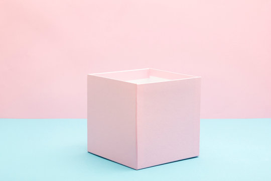 Empty, open white gift box on blue background with copy space
