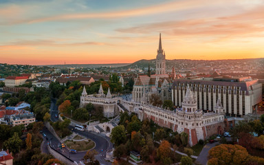 Fisherman's bastion is the famous historical building in Buda castle, Budapet Hungary. I took this picture in autumn.  Fantastic colors and mood with sunset.