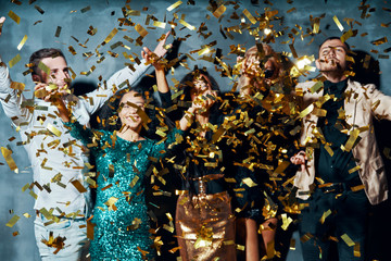 Group of friends enjoying party and throwing confetti Wall mural