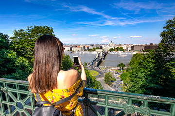 A young woman taking pictures of Budapest