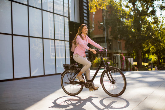 Young woman riding an electric bicycle