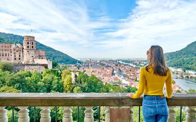 Tourist in Heidelberg town on Neckar river in Baden-Wurttemberg, Germany