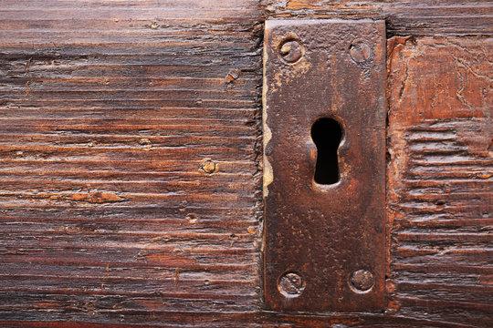 Lock keyhole on old wooden door