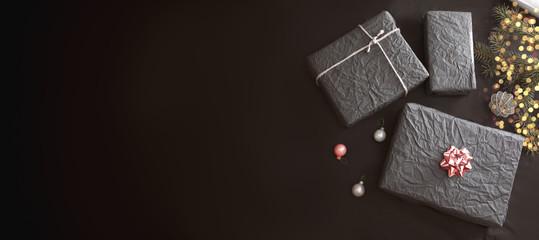 Black wrapped Christmas gift box o table
