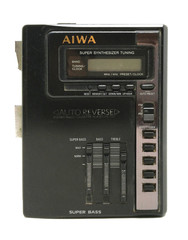 Old dirty AIWA portable audio compact cassette / radio player isolated on white background.