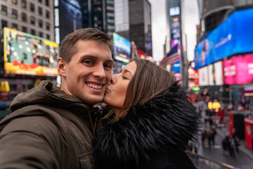 young couple self portrait in times square