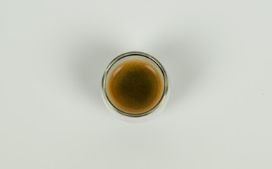 Espresso in modern cup on white background
