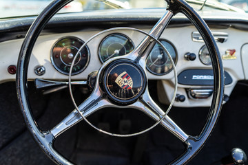 Interior of sports car Porsche 356B, on May 06, 2018 in Berlin, Germany. Focus on the foreground.