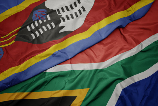 waving colorful flag of south africa and national flag of swaziland.