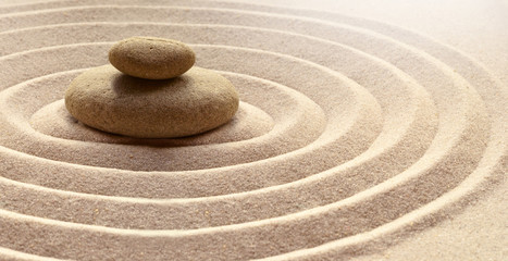 Photo sur Plexiglas Zen pierres a sable zen garden meditation stone background with stones and lines in sand for relaxation balance and harmony spirituality or spa wellness