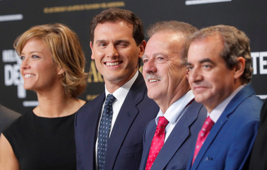 Leader of Ciudadanos' party Albert Rivera winks as he poses for a picture before televised debate ahead of general elections in Madrid