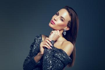 Young celebrity woman in glitter dress posing portrait