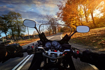 Driving a motorbike on an autumn sunny day
