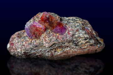 Natural raw gem ruby crystal. Rough and uncut in red  Gem ruby in raw form
