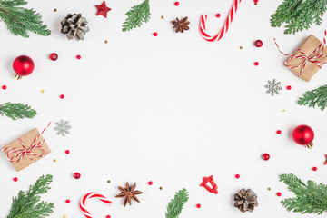 Christmas or Happy New Year composition. Frame made of fir tree branches, holiday decorations,...